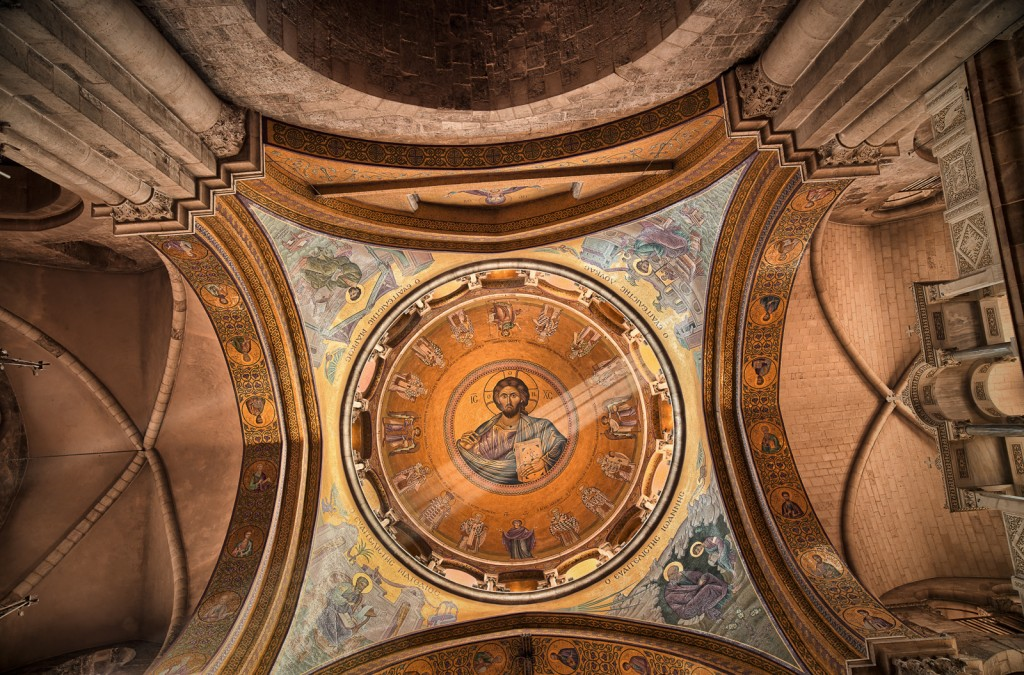 "The inner dome of the Greek Orthodox Catholicon inside the Church of the Holy Sepulchre, directly above ""the omphalos"", once believed by Christians to mark the navel of the world."