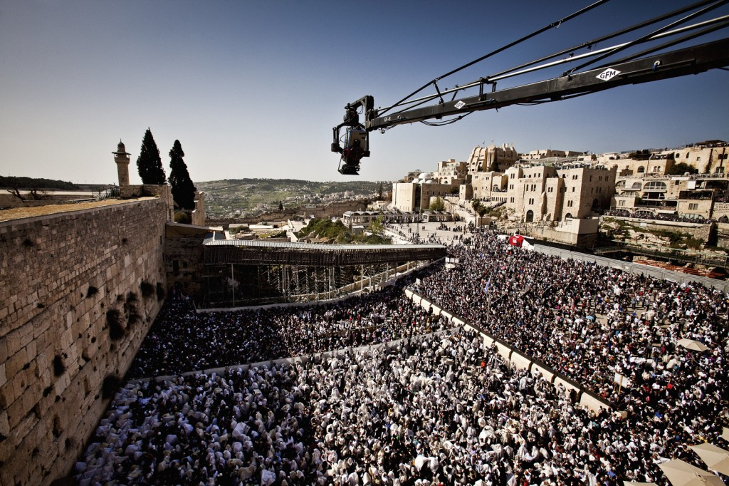 "The IMAX® camera mounted on a crane films an unprecedented perspective of the Birkat Kohanim or ""priestly blessing"", at the Western Wall during Pesach."